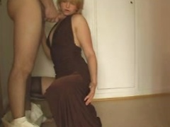 Blowjob in the hallway from a sexy teasing blonde wife in stockings
