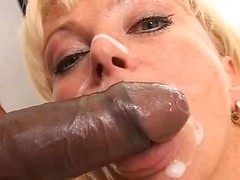 Thick and sticky cum covers the face of this lovely blonde milf with pretty eyes