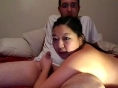Busty Chinese webcam girl grabs his dick and gives a beautiful handjob